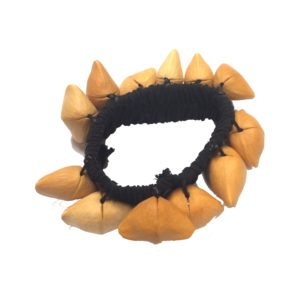 This is a product image of the Ankle Shaker - Kenari. It has a black elastic strap with light brown Kenari shells attached all the way around.