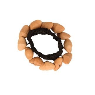 This is a product image of the Bracelet Shaker - Kenari. It has a black elastic strap with brown Kenari shells attached all the way around.
