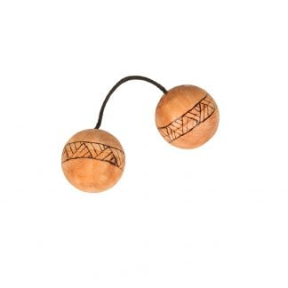 This is a product image of the Cascas (Kashaka). They are two wooden balls attached by a short length of rope. Each ball has a line pattern burned around the circumference.