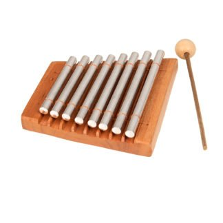 This is a product image of the Chime Bar - 8 notes, stainless. It has a wooden trapezoid body with eight chime bars attached. The beater is lying to the right and the instrument is gently angled to the right.