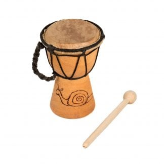 This is a product image of the Djembe Drum - Budget - 3in diameter, 15cm high, Early Years from the side, showing the wood burnt image on the shell. The beater is lying next to it.