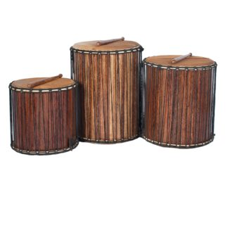 This is a product image of a Dundun Set - Large - recycled wood from the side with a beater resting on each drum. It contains a Kenkeni: 35cm diameter by 40cm high, a Dundun: 45cm diameter by 60cm high and a Sangban: 40cm diameter by 50cm high.