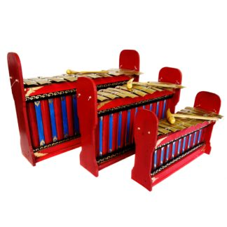 This is a product image of the Gamelan - Budget - 10 key - 3 Pack. It contains three red and blue instruments with gold keys suspended by wire, angled in a row and facing to the right. Each instrument has a beater laying on it. The image shows the Gamelan (Gangsa Ugal) - Budget - Large 10 key, Gamelan (Gangsa Pemad?) - Budget - Medium 10 key and Gamelan (Gangsa Kantilan) - Budget - Small 10 key.