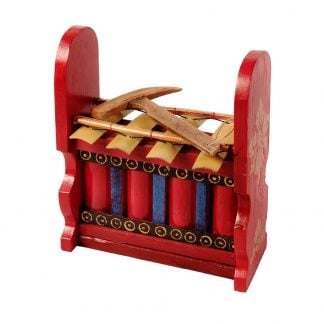 This is a product image of the Gamelan - Budget - Medium 4 key. The instrument has four gold keys suspended by bamboo and wire. The casing is mainly red with some blue, gold and black decoration. A beater is laying on top of the instrument. The image has been taken from the front and the instrument is facing slightly to the left.