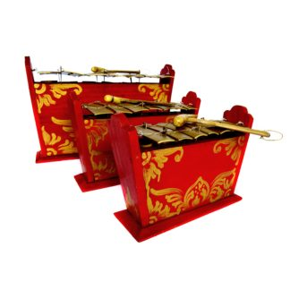 This is a product image of the Gamelan - Standard - 7 key - 3 Pack. The three instruments are red and blue with gold keys suspended from wire and each with a beater resting on the bars. The image shows the instruments in partial profile and closely placed together facing to the right. From left to right the image contains contains the Gamelan - Standard - Large 7 key, Gamelan - Standard - Medium 7 key and Gamelan - Standard - Small 7 key.