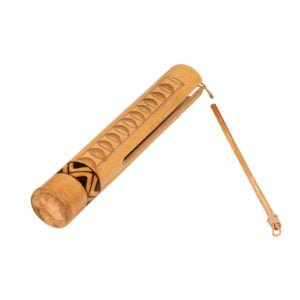 This is a product image of the Guiro - Small - bamboo. It is a light wooden Guiro with a sound slit down three quarters of the instrument, a ridged section, and a line pattern burnt around the circumference at the intact end. The instrument is lying from bottom left to top right and the stick is lying beside it.