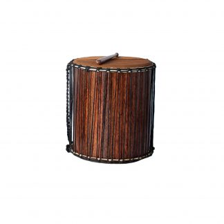 This is a product image of the Sangban - 16in diameter, 50cm high, recycled wood. It is standing upright with one of the handles draped downwards to the left. A Dundun Beater is lying on top of the drum.